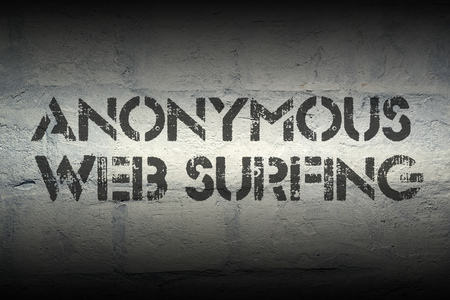 web surfing: anonymous web surfing stencil print on the grunge white brick wall Stock Photo