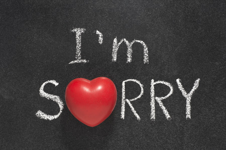 i am sorry: I am sorry phrase handwritten on blackboard with heart symbol instead of O