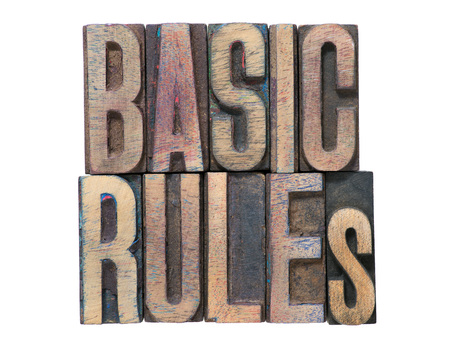 basic rules phrase made from mixed wooden letterpress type isolated on white