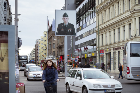 cold war: BERLIN - JANUARY 16: street view to Checkpoint Charlie point in Berlin, Germany on January 16, 2015. This place is famous Berlin Wall crossing between East Berlin and West Berlin during the Cold War. Editorial