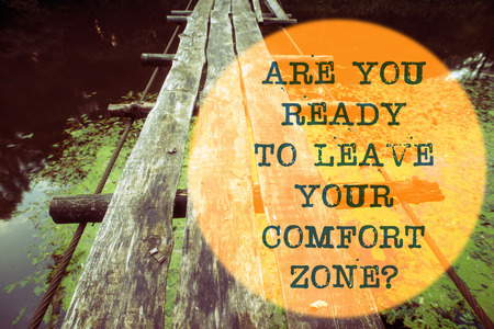 are you ready to leave your comfort zone question written on wooden rope bridge landscape