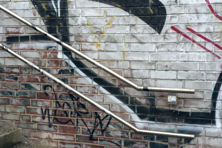 handrails: urban  painted wall near stairway with metallic handrails