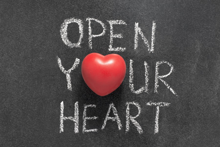 open your heart: open your heart phrase handwritten on chalkboard with heart symbol instead of O Stock Photo
