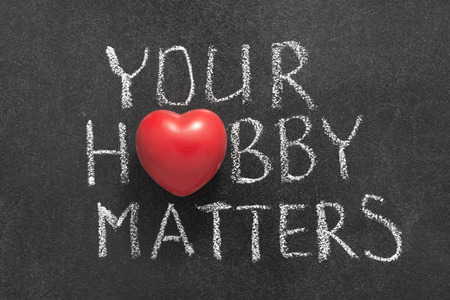 inclination: your hobby matters phrase handwritten on chalkboard with heart symbol instead of O