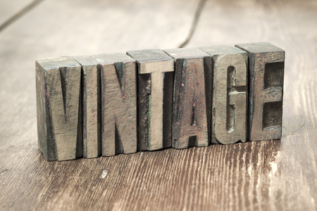 letterpress type: vintage word made from wooden letterpress type on grunge wood