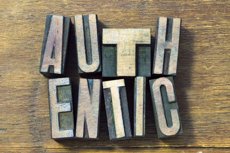 authentic: authentic word made from wooden letterpress type on grunge wood
