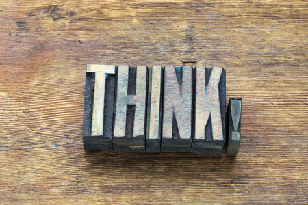 letterpress type: think word made from wooden letterpress type on grunge wood Stock Photo
