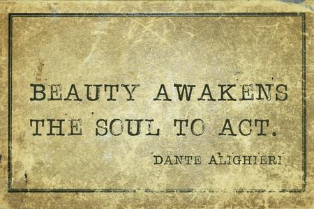 dante alighieri: Beauty awakens the soul to act - ancient Italian poet and philosopher Dante Alighieri quote printed on grunge vintage cardboard