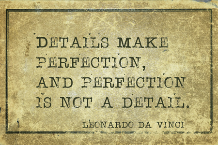 leonardo: Details make perfection, and perfection - ancient Italian artist Leonardo da Vinci quote printed on grunge vintage cardboard Stock Photo