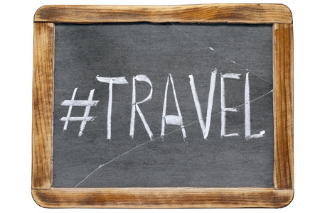 redirect: travel hashtag handwritten on vintage school slate board isolated on white