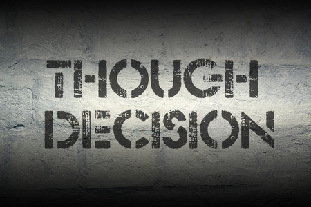 though: though decision stencil print on the grunge white brick wall Stock Photo