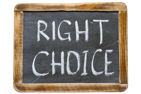 right choice: right choice phrase handwritten on vintage school slate board isolated on white