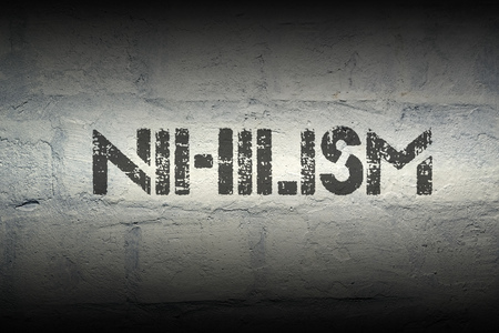 rejections: nihilism word stencil print on the grunge white brick wall Stock Photo