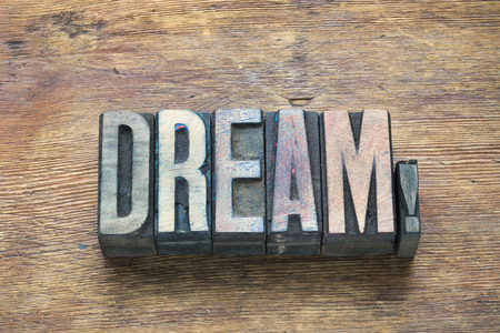 letterpress type: dream word made from wooden letterpress type on grunge wood