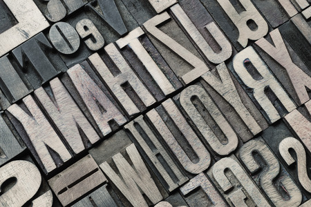 letterpress type: angle view to the detailed vintage wooden letterpress type background Stock Photo