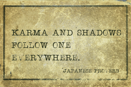ancient japanese: Karma and shadows follow one everywhere - ancient Japanese proverb printed on grunge vintage cardboard