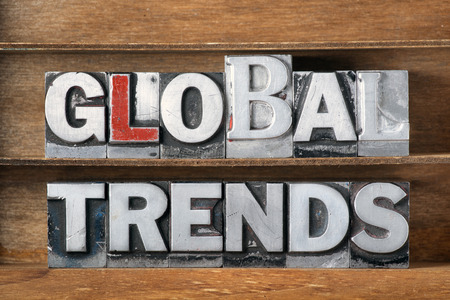 common vision: global trends phrase made from metallic letterpress type on wooden tray Stock Photo