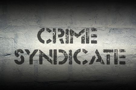 syndicate: crime syndicate stencil print on the grunge white brick wall
