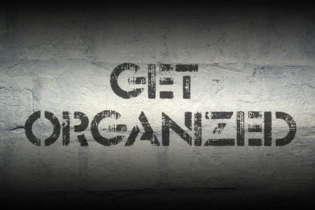 obey: get organized stencil print on the grunge white brick wall