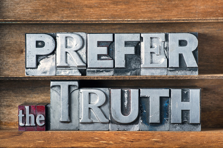 to prefer: prefer the truth phrase made from metallic letterpress type on wooden tray Stock Photo