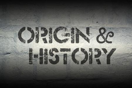 fundamentals: origin and history stencil print on the grunge white brick wall