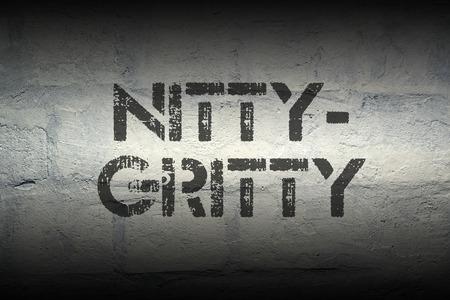fundamentals: nitty-gritty stencil print on the grunge white brick wall Stock Photo