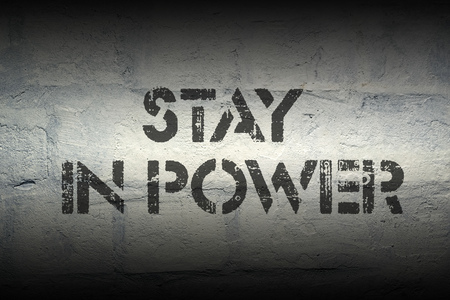 stay on course: stay in power stencil print on the grunge white brick wall Stock Photo