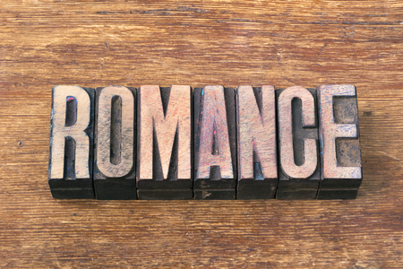 letterpress type: romance word made from wooden letterpress type on grunge wood Stock Photo