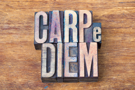 horace: carpe diem - famous ancient Roman poet Horace quote with meaning - seize the day, made from wooden letterpress type on grunge wood