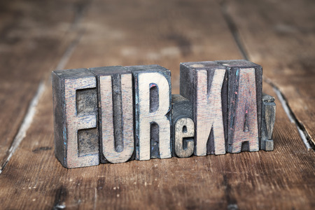 letterpress type: eureka exclamation made from wooden letterpress type on grunge wood Stock Photo