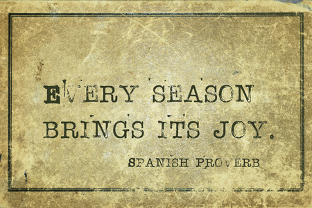 proverb: Every season brings its joy - ancient Spanish proverb printed on grunge vintage cardboard Stock Photo