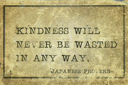ancient japanese: Kindness will never be wasted - ancient Japanese proverb printed on grunge vintage cardboard