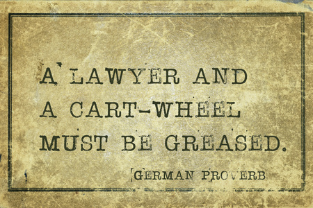 proverb: A lawyer and a cart-wheel must be greased - ancient German proverb printed on grunge vintage cardboard