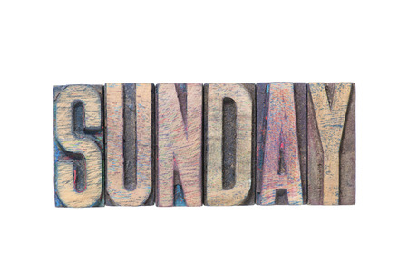 letterpress type: Sunday word made from wooden letterpress type isolated on white
