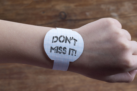 hand with handmade  paper watches and don?t miss it exclamation print