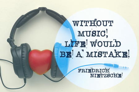 philosophy of music: Without music, life would be a mistake - ancient German philosopher Friedrich Nietzsche quote printed on image with headphones around red heart