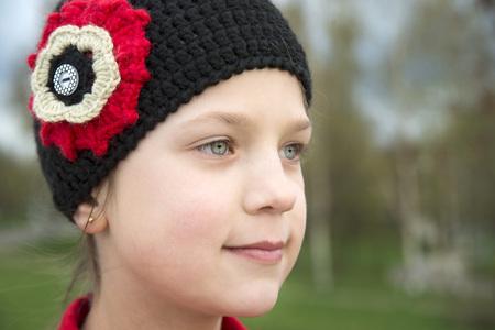 knitwear: close up portrait of girl in black knitwear cap outdoor