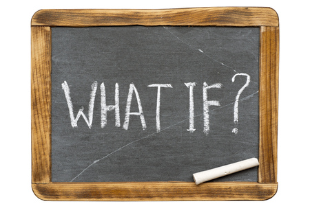 what if question handwritten on vintage isolated slate chalkboard with piece of chalk