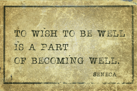 seneca: To wish to be well is a part of becoming - ancient Roman philosopher Seneca quote printed on grunge vintage cardboard Stock Photo