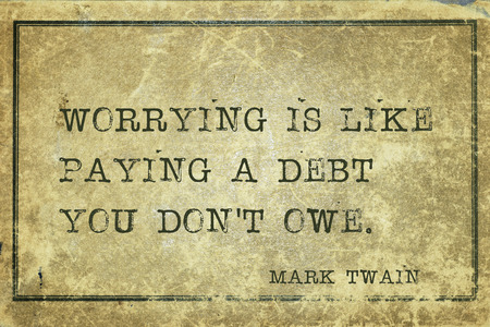 worrying: Worrying is like paying a debt you  -  famous American writer Mark Twain quote printed on grunge vintage cardboard Stock Photo