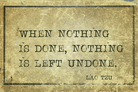 paradox: When nothing is done, nothing is left undone - ancient Chinese philosopher Lao Tzu quote printed on grunge vintage cardboard