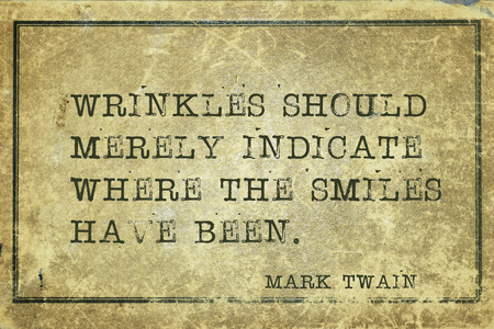 twain: Wrinkles should merely indicate where the smiles have been  -  famous American writer Mark Twain quote printed on grunge vintage cardboard
