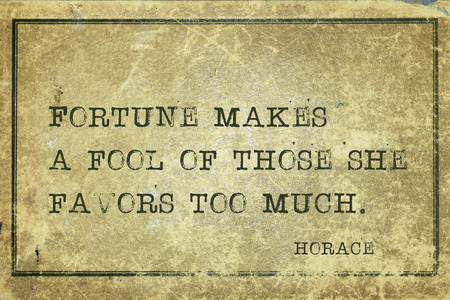 horace: Fortune makes a fool of those she favors too much - ancient Roman poet Horace quote printed on grunge vintage cardboard Stock Photo