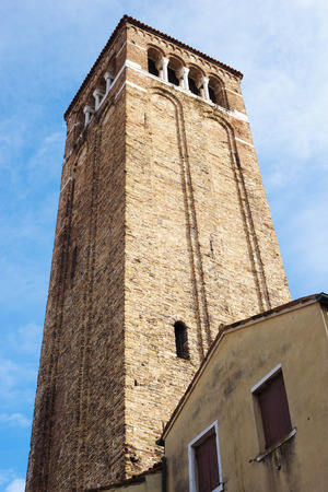 made in italy: ancient bell tower made from red bricks in Venice, Italy Stock Photo