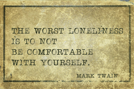 the worst: The worst loneliness is to not be comfortable with yourself -  famous American writer Mark Twain quote printed on grunge vintage cardboard
