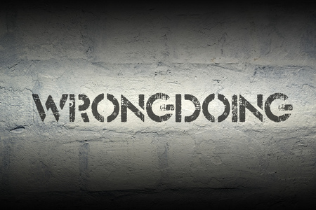 wrongdoing: wrongdoing word stencil print on the grunge white brick wall