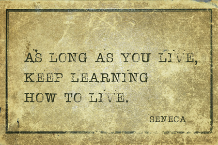 seneca: As long as you live, keep learning how to live - ancient Roman philosopher Seneca quote printed on grunge vintage cardboard