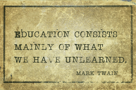 twain: Education consists mainly of what we have unlearned - famous American writer Mark Twain quote printed on grunge vintage cardboard Stock Photo