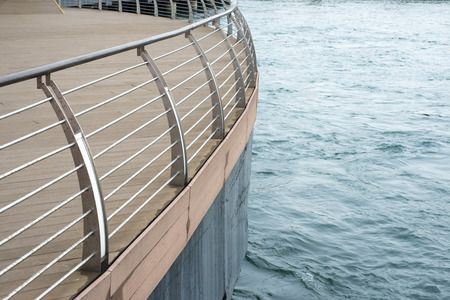 handrails: water edge with deck protected by modern metallic handrails