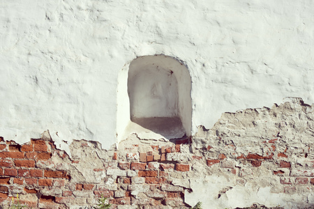 loophole: ancient weathered brick wall with walled loophole Stock Photo